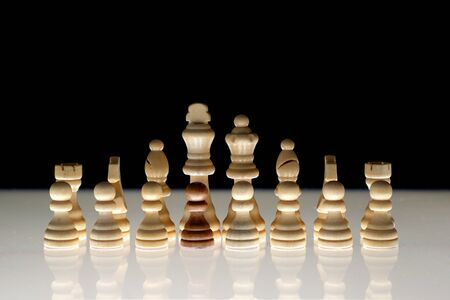 Photo pour White chess formation with a single black piece as a concept for undercover operations, infiltration, racial tension, ethnic minorities. - image libre de droit