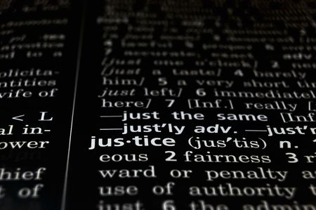 The word Justice in a dictionary, white on black