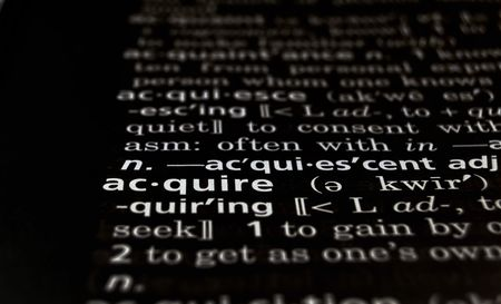 The word Acquire in a dictionary, white on black