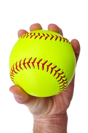 Player Gripping a Yellow Softball Isolated on White
