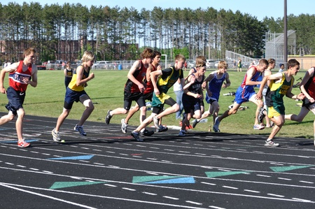 NORTH BRANCH, MN - May 27: Unidentified Teen Boys Starting a Long Distance High School Track Meet Race on May 27, 2010 in North Branch, Minnesota.