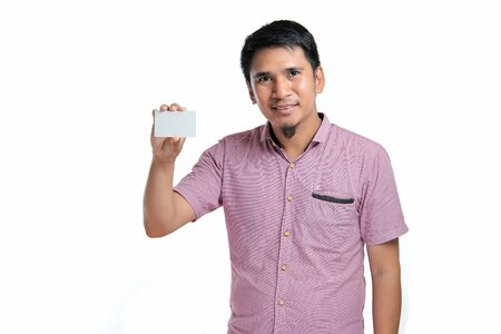Photo for Portrait of smiling Asian man holding white blank business card on white background - Royalty Free Image
