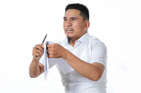 Foto de Young Asian entrepreneur/freelancer or business man dizzy or angry, isolated on white - Imagen libre de derechos