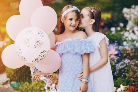 Photo pour Children with ballons - image libre de droit