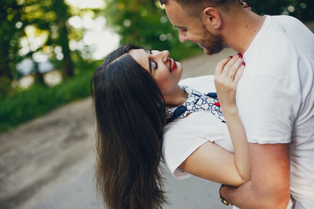 Photo for Beautiful couple spend time in a summer park - Royalty Free Image