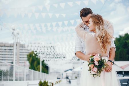 Photo pour Beautiful bride with her husband in a park - image libre de droit