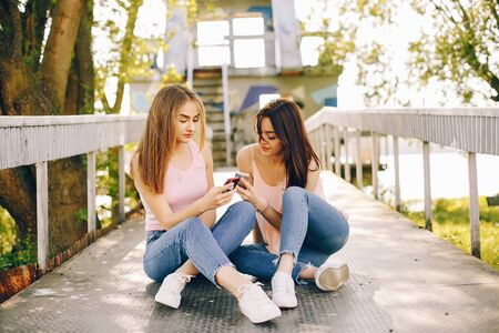 Photo for two beautiful girls in a park - Royalty Free Image