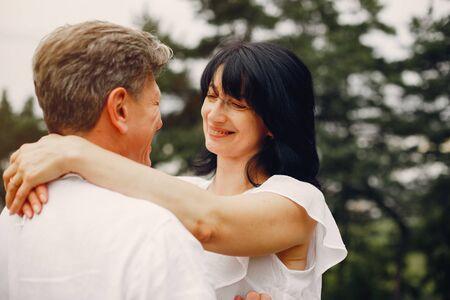 Photo pour Beautiful adult couple spend time in a summer field - image libre de droit