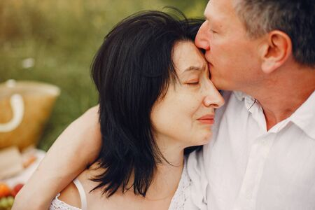 Photo for Beautiful adult couple spend time in a summer field - Royalty Free Image