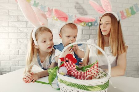 Photo pour Mother with daughter in a kitchen prepare to easter - image libre de droit