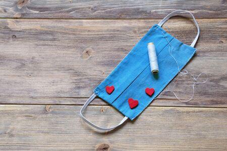 Photo pour Home-made blue protective mask . Love protects, concept. Copy space - image libre de droit