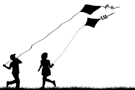 Silhouettes of children flying kites