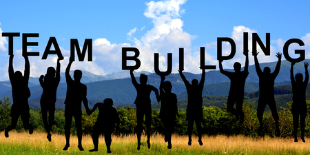Photo for Silhouettes of people holding letters with TEAM BUILDING at mountains - Royalty Free Image