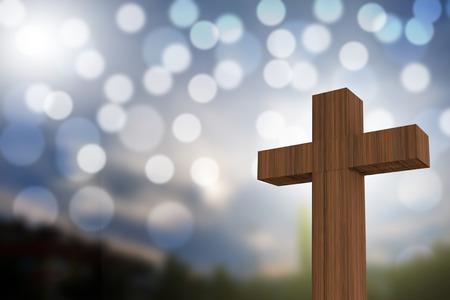 3D rendering of wooden cross on a blue sky with sunlight and bokeh, god/love concept