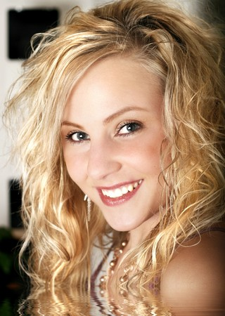 Curly blond hair - pretty teen girl -