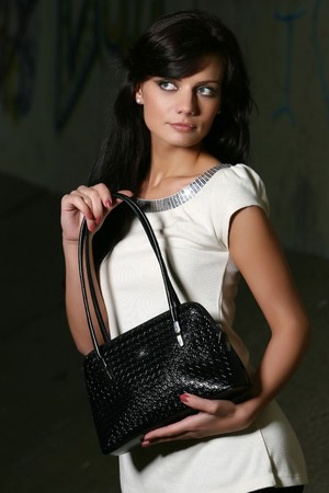 cute brown haired girl model with luxury handbag