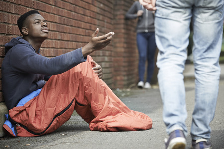 Photo for Homeless Teenage Boy Begging For Money On The Street - Royalty Free Image