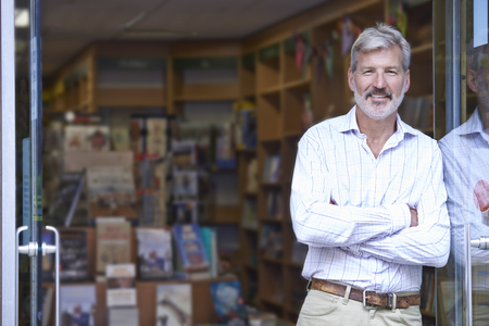 Portrait Of Male Bookshop Owner Outside Storeの写真素材