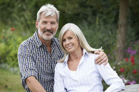 Portrait Of Mature Couple Relaxing In Garden Together