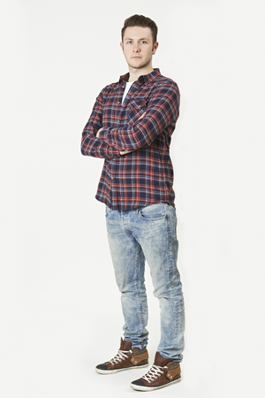 Photo pour Full Length Portrait Of Man Standing In Studio On White Background - image libre de droit