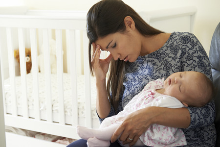 Photo pour Tired Mother Suffering From Post Natal Depression - image libre de droit