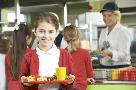 Female Pupil With Healthy Lunch In School Cafeteria