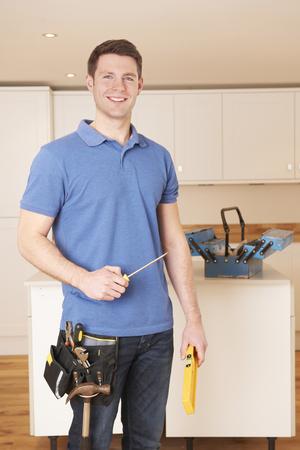 Workman Installing Fitted Kitchen