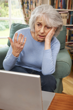 Frustrated Senior Woman Using Laptop