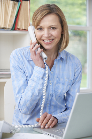 Woman On The Phone In Home Office