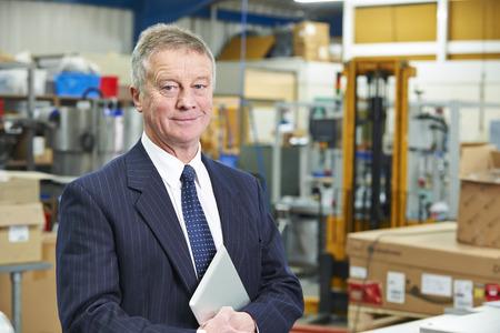 Foto de Portrait Of Factory Owner With Digital Tablet - Imagen libre de derechos