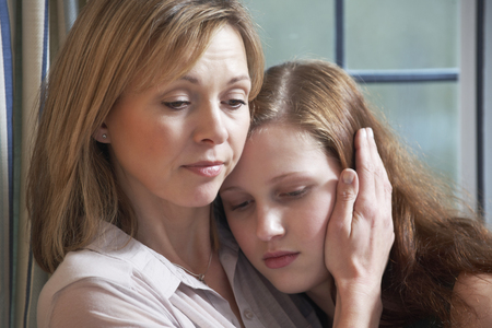 Photo for Mother Comforting Teenage Daughter - Royalty Free Image
