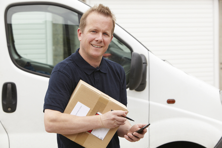 Photo for Courier Delivering Package Requiring Signature - Royalty Free Image