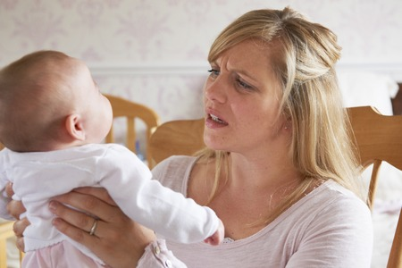 Photo pour Frustrated Mother Suffering From Post Natal Depression - image libre de droit