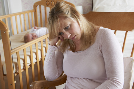 Mother In Nursery Suffering From Post Natal Depression