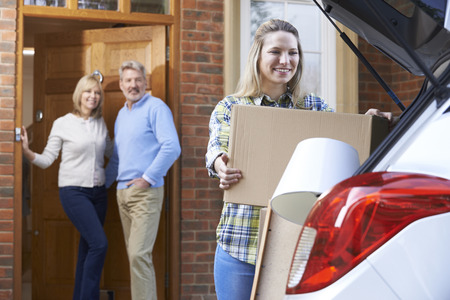 Photo pour Adult Daughter Moving Out Of Parent's Home - image libre de droit