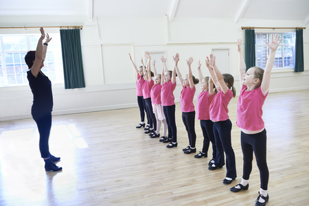 Group Of Girls In Tap Dancing Class With Teacher