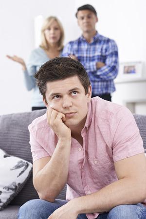 Foto de Mature Parents Frustrated With Adult Son Living At Home - Imagen libre de derechos