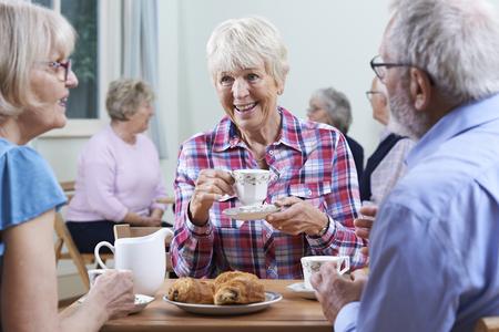 Foto de Group Of Seniors Meeting At Social Club - Imagen libre de derechos