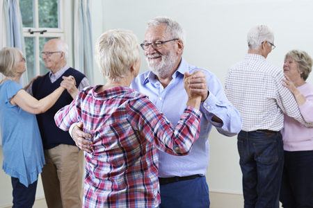 Photo for Group Of Seniors Enjoying Dancing Club Together - Royalty Free Image