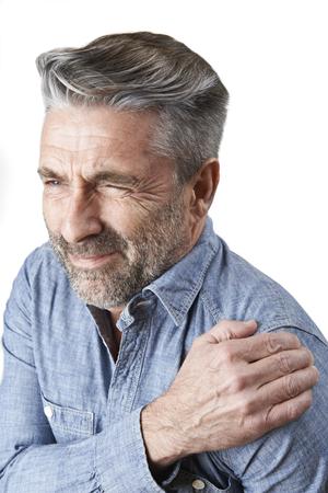 Photo pour Studio Shot Of Man Suffering With Frozen Shoulder - image libre de droit