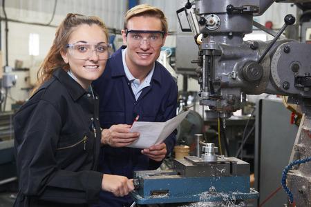 Foto für Portrait Of Engineer Showing Apprentice How to Use Drill In Factory - Lizenzfreies Bild