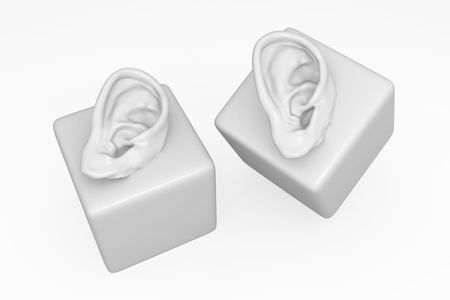 Isolated 3d human ear model on cube, over white