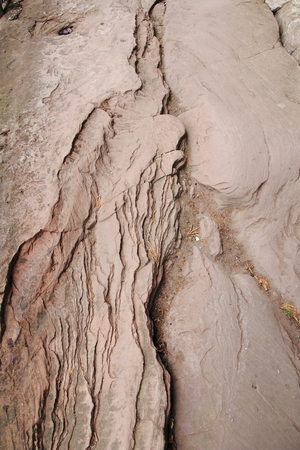 andstone rocks, rocks with deep tears and callings in beige gray