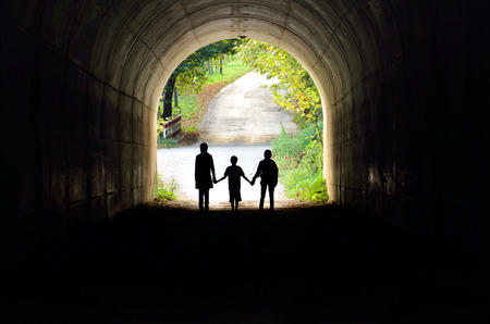 family silhouette in back lighting