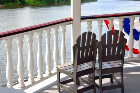 Chairs on deck of cruise ship floating down the Mississippi River