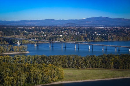 Photo for Interstate Highway bridge connecting Oregon and Washington, over the Columbia River.  Scenic views of river and land. - Royalty Free Image