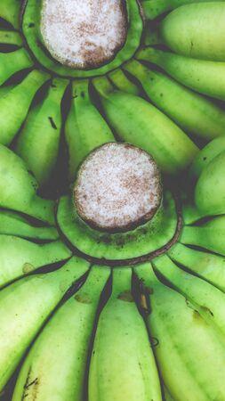Foto für Bunch of raw green bananas sold at traditional market in Indonesia - Lizenzfreies Bild