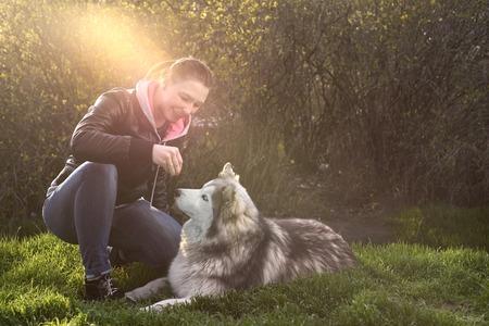 Husky woman walks in the park