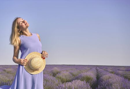 Foto für cute woman faces the sun on a lavender field - Lizenzfreies Bild