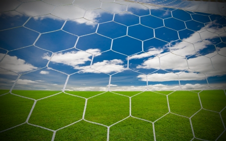 soccer goal under the blue sky